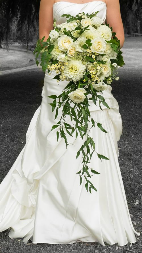 Loving this green and cream wedding bouquet with dahlia's, avalanche roses and matrecaria.