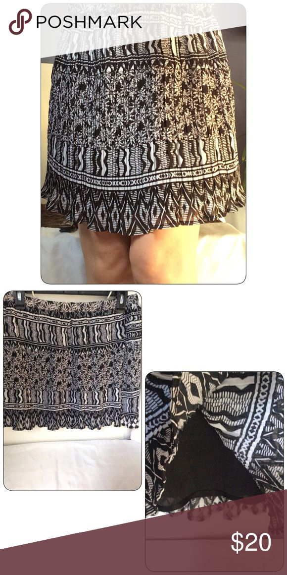 Macy's American Rag Black & White Skirt NWT Macy's American Rag clothing line. Black & White pleated skirt which adds fullness. Black slip underneath. 100% Polyester. Machine wash. American Rag Skirts