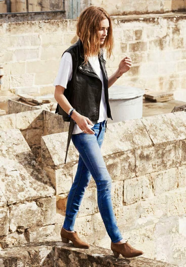 moto vest, t-shirt and distressed denim