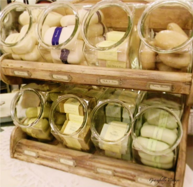 Variety of French Milled Soaps in a wooden cabinet with candy jars -Great Valentine display