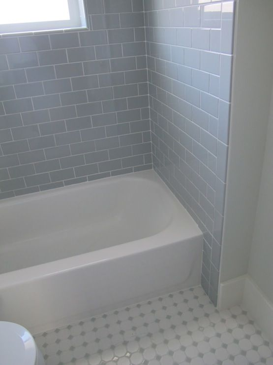 white and gray bathroom with with daltile desert gray subway tile shower surround dropin tub and octagon and dot tile in desert gray from datile