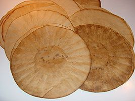 Coffee stained coffee filters - to use in collage backgrounds, tearing...still absorbant.  I wonder how food color would work?