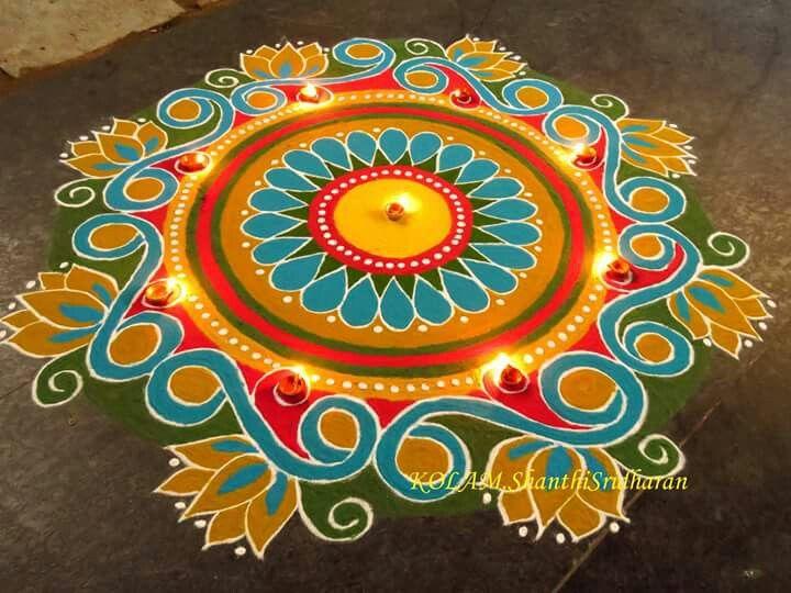 Bright coloured rangoli by Shanthi.