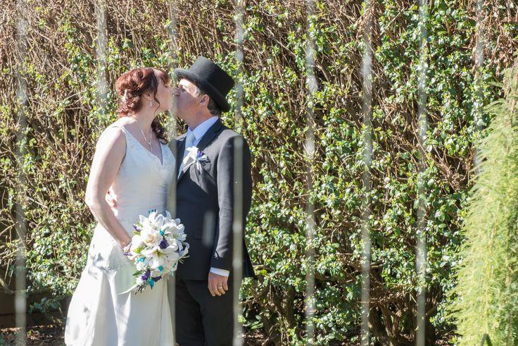 Candid Photos of a Lifetime Having a little kiss near the water feature at Gairloch Gardens, Oberon www.candidphotosofalifetime.com.au