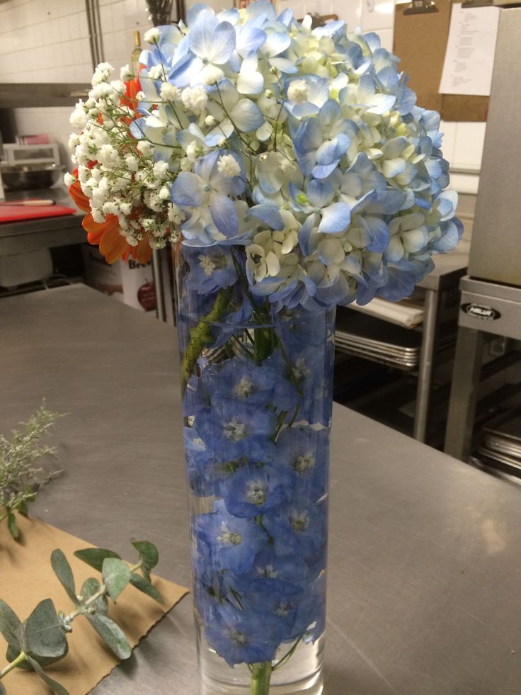 Getting ready for a corporate event! Submerged delphiniums topped with hydrangeas, gerbera daisies, and baby's breath