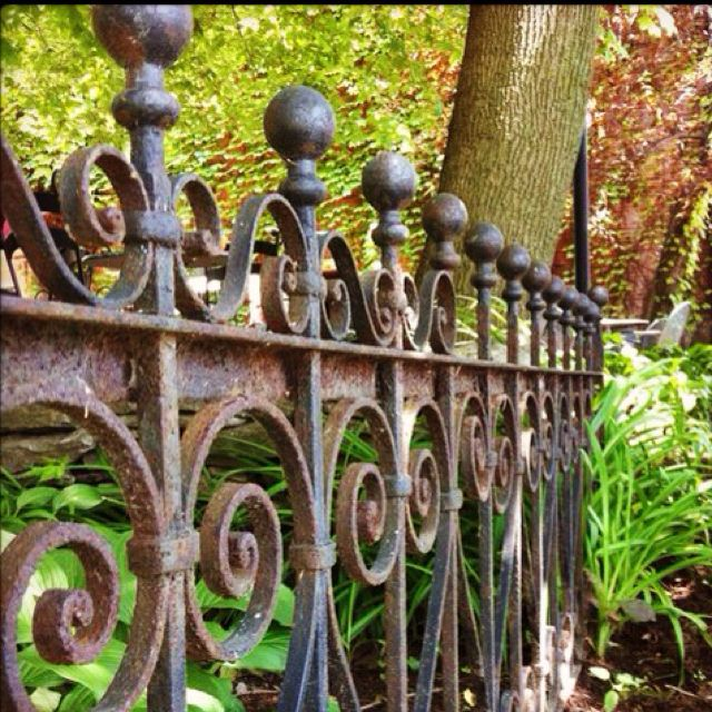 Pretty iron fencing--though I'm not sure whether it's for keeping baddies out or keeping the crazies in...