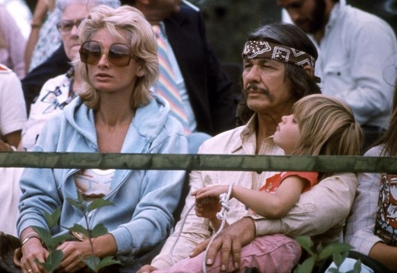 Charles Bronson  AFP / Getty Images  Sixties and '70s Hollywood badboy Charles Bronson takes in the Olympic Games in Montreal with his daughter and his wife, Jill Ireland, in July 1970.: Actor Entertainment, Movies Stars, Jill Ireland, Bronson Families, Charles Bronson, Daughters, Parents Style, Dads, Photo