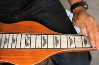 How to Play a Lap Steel Guitar | eHow