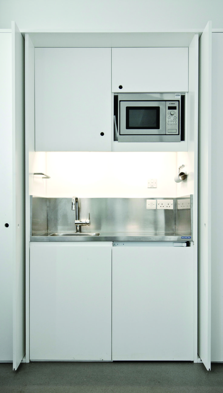Alcove tea point with stainless steel worktop and splashbacks, using GEC Anderson's Decimetric System