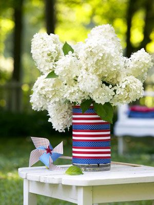 Blossom Fourth:  All-white flowers like hydrangeas seem instantly all-American presented in a vase that evokes the stars and stripes. Measure the vase's circumference, then cut lengths of patriotic ribbon to size. Attach with double-sided tape to cover the vase.    Read more: Fourth of July Party Decorations - Patriotic Decoration Ideas - Good Housekeeping