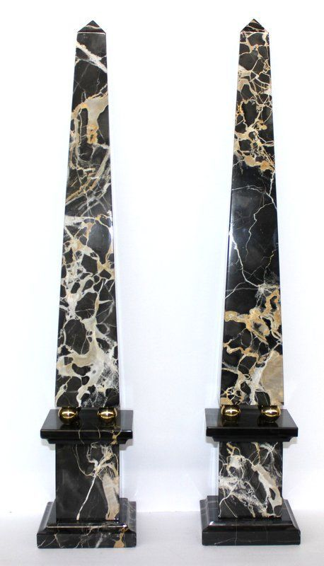 """A beautifull pair of XXth century black marble Obelisks with some delicate veinage (probably portoro marble), sitting on 4 gilded balls... with typical base. Each Obelisk measures 26"""" high."""