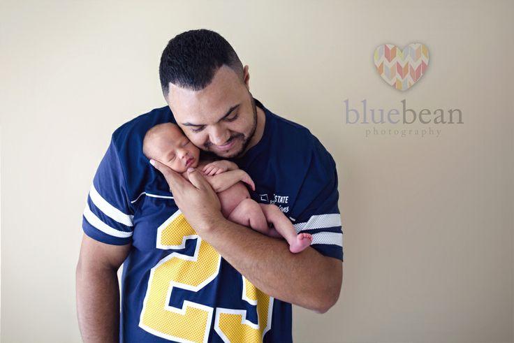 Newborn boy and daddy in arms ~ football top!  Blue Bean Photography ~ Newborns www.bluebeanphotography.co.uk www.newbornphotographycoventry.co.uk