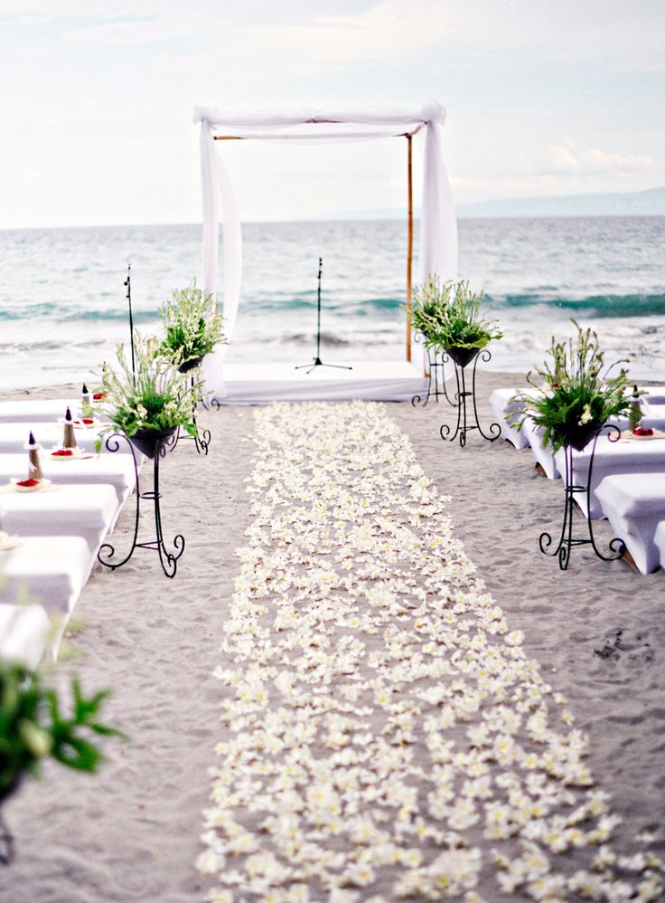 Frangipani strewn ceremony aisle! Ryan and Daphne's Romantic Bali Wedding at Amankila Resort.