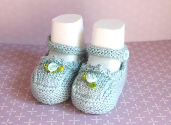 Pretty little blue baby booties hand knitted in a soft and silky yarn. Luxuriously soft with silk and cashmere, they are perfect for sensitive little