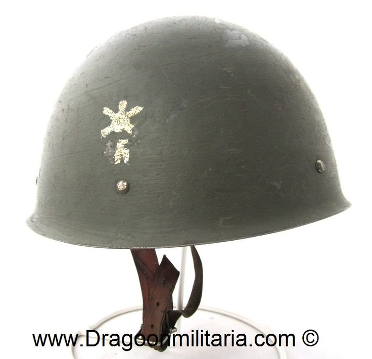 """WW2 Finnish army M40 steelhelmet. Helmet right side with white painted Anti-aircraft troop emblem. This type of insignia was used mainly by Helsinki AA-unit´s.  WW2 period paint.  Helmet is stamped """"72 W"""", which means helmet size and W= Wärtsilä."""