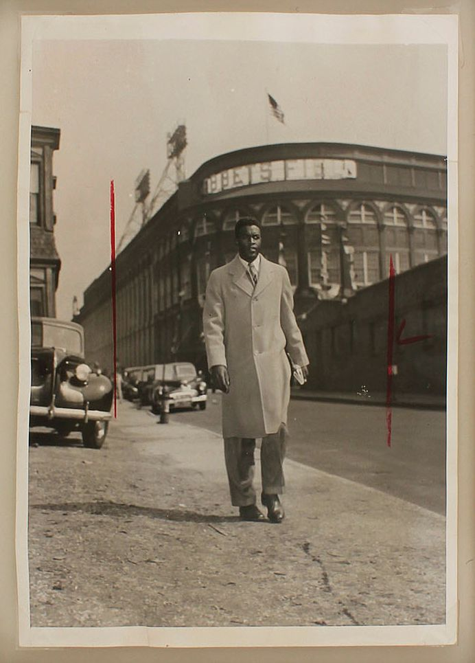 Jackie Robinson leaves Ebbets Field after playing opening day with the Brooklyn Dodgers, April 15, 1947.