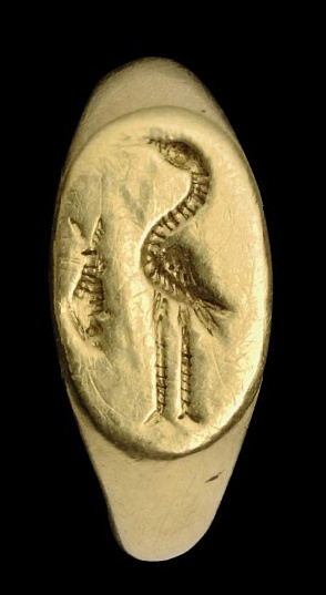 A ROMAN GOLD RING CIRCA 2ND-3RD CENTURY A.D. The hoop with gently angled shoulders, the oval bezel with the standing figure of a stork facing left, a fish swimming vertically at the side, details dotted and incised ¾ in. (2 cm.) across inner hoop