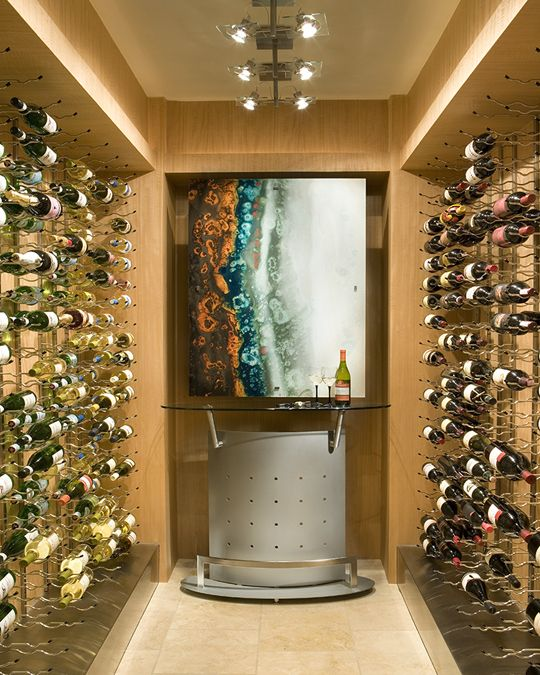 Conversion of a closet to a new contemporary wine room with Anigre walls…