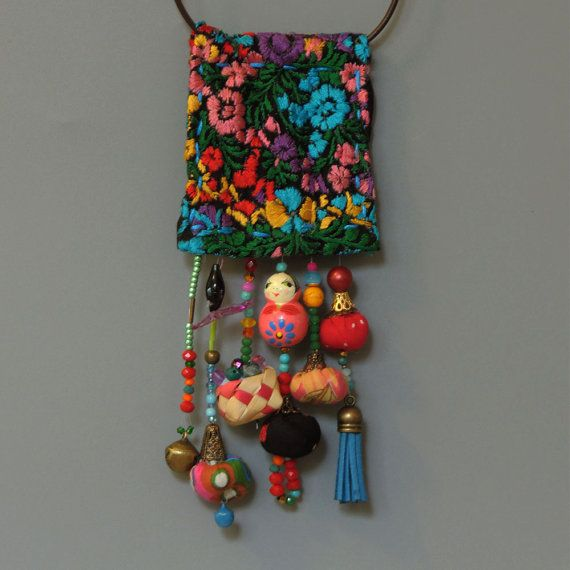 Ecofriendln Mexican Jewelry, OOAK and unique long statement fabric pendant necklace, you will not see anywhere else! The unique Mexican vintage fabric and the composition of all dangling element creates a fabulous boho style statement pendant. Measurment: all pendant : 56cm - 22.04 Fabric pendant: 18cm - 7.08 ★This item is READY TO SHIP and will be on its way to you within 3-5 days ★ Ready to be gifted It will be sent to you in a beautiful gift box. This necklace would look s...