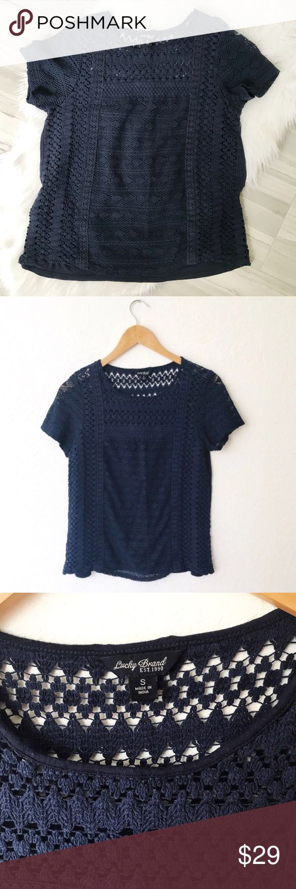 Lucky Brand Navy Lace Crochet Short Sleeve Top Excellent preowned condition. Beautiful Navy Blue Lace in the front and partially in the back, short sleeves, Loose fitting. Lucky Brand Tops