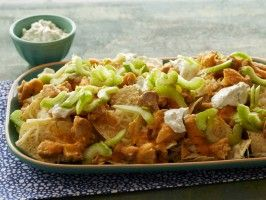 Spicy Buffalo Chicken Nachos : Recipes : Cooking Channel If you thought your favorite wings couldn't get any better, think again: This nacho version of buffalo wings has it all. Spicy hot sauce-coated chicken and creamy blue cheese-flavored sour cream are spread over cheesy chips along with celery for heat-balancing crunch.