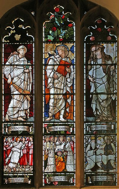 Stained glass in Jesus College chapel, Cambridge. Made by William Morris to a design by Edward Burne-Jones. This depicts John the evangelist, flanked by Sybils.