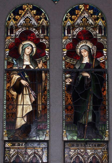 Stained glass windows featuring St. Teresa of Avila and St. Bridget of Kildare, at St. Joseph's Catholic Church, Macon, GA.
