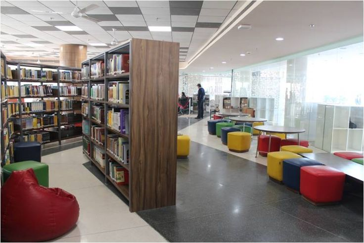 The superb range of Cast in Situ Terrazzo floors in a blend of different colours used at a library. These plain tiles add elegance and beauty to any space, be it your home, office or a public space. Location: Ashoka University, Delhi.  Interiors: Abaxial Architects.