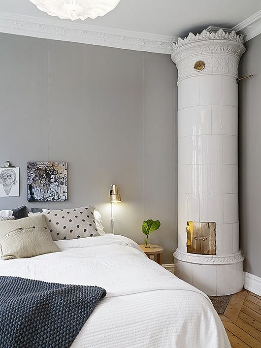 Trendenser - A vintage, wood-burning ceramic stove in the bedroom...absolutely!