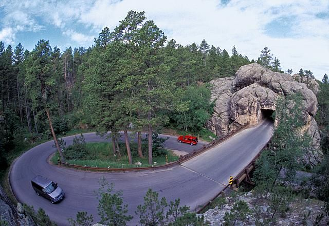 "Iron Mountain Road, Black HIlls SD is a work of art in itself. The hwy connects Custer State Park & Mount Rushmore. It includes 3 tunnels that frame Mount Rushmore in the distance. It is also famous for ""Pigtail Bridges""   It was constructed in the '30s   Iron Mountain Road, "" is not meant to be a super highway, to do the scenery justice you should drive no more than 20 mph & to do it full justice you should simply get out and walk."" Experience the road that engineers once said couldn't be…"