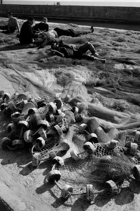 Ara Guler TURKEY. 1965. Men sleeping among the nets at Kumkapi.