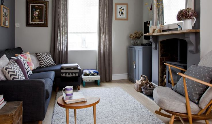 Toning grey walls teamed with upcycled furniture and vintage finds give this living room a cosy feel.   - housebeautiful.co.uk