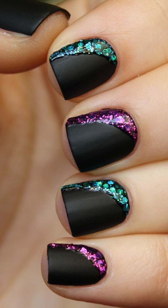 Black Matte Nails With Purple And Green Glitter Design