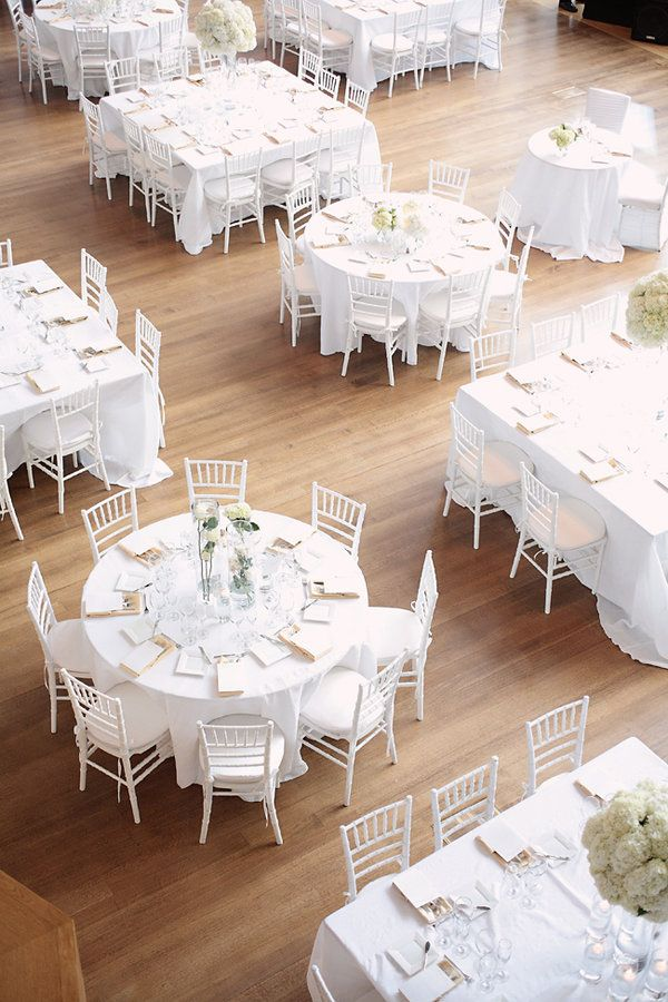 Who knew white could be so beautiful? White chiavari chairs, white linens, and white flowers.