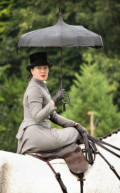 sidesaddle...how brave! - lol - given the physical difference between men and women, it has long been said that men should be the ones to ride side saddle!