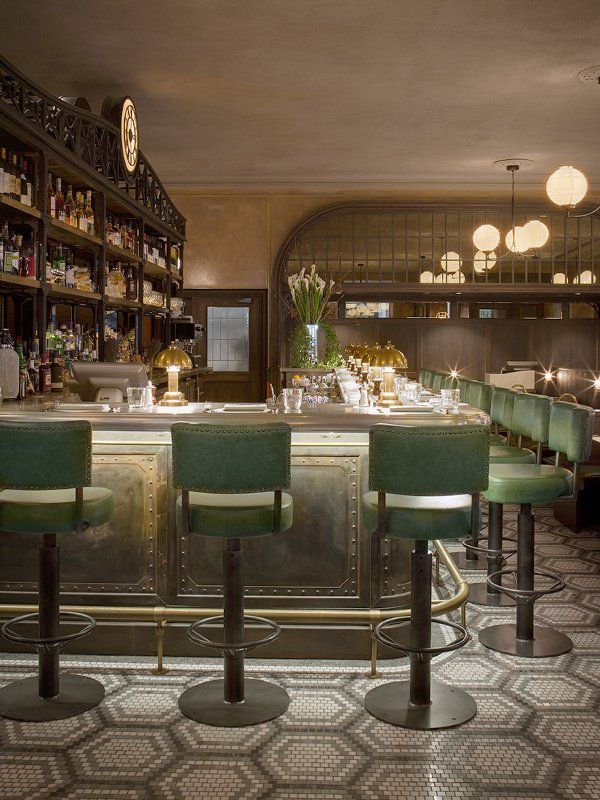 The Ivy Market Grill | Upholstered Bar Stools. Bar Chairs. Modern Chairs. Restaurant Interior. #restaurantinteriors #barchair #barstool Read more: https://www.brabbu.com/en/inspiration-and-ideas/world-travel/sophisticated-upholstered-bar-stools-want