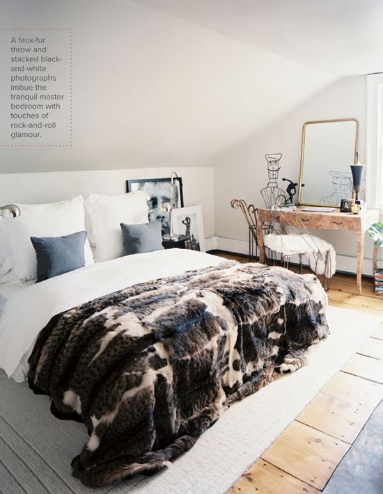 Faux fur throw and an eclectic bedroom decor via Lonny