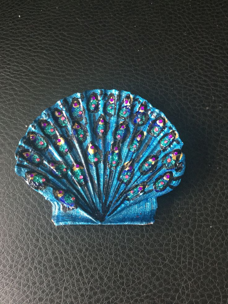 Peacock tail I painted on a scallop shell