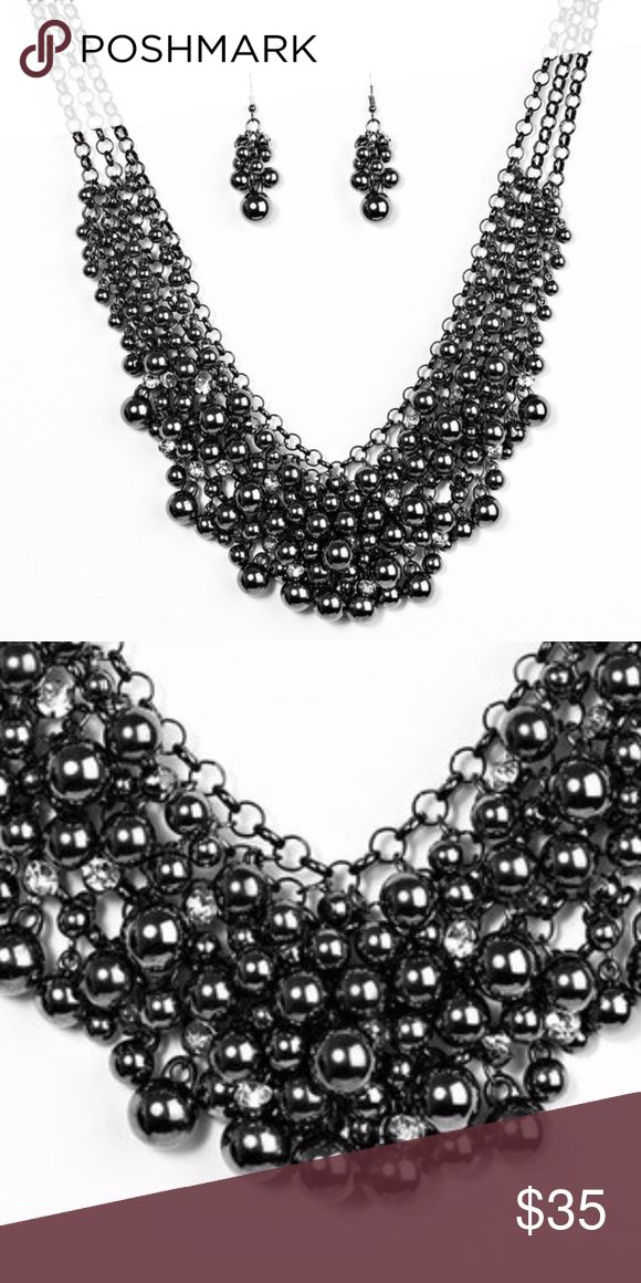 Black Pearls Necklace Black chain links glamoured with faux black pearls.  This necklace can make a plain body fit dress look dazzling either for a posh dinner party or a fine dine restaurant reservation. Jewelry Necklaces