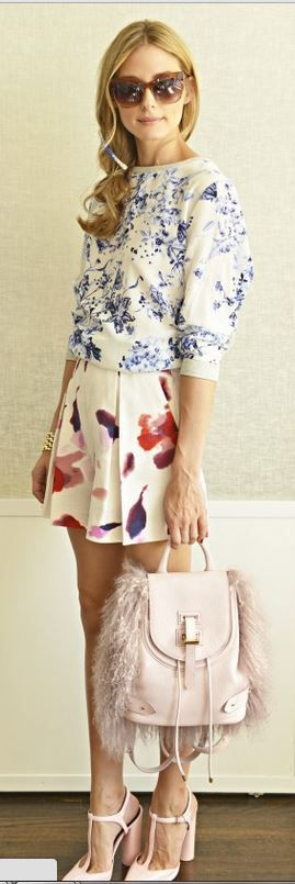 Olivia Palermo's blue floral top, water color shorts, feather back pack, brown sunglasses, and pink t pumps