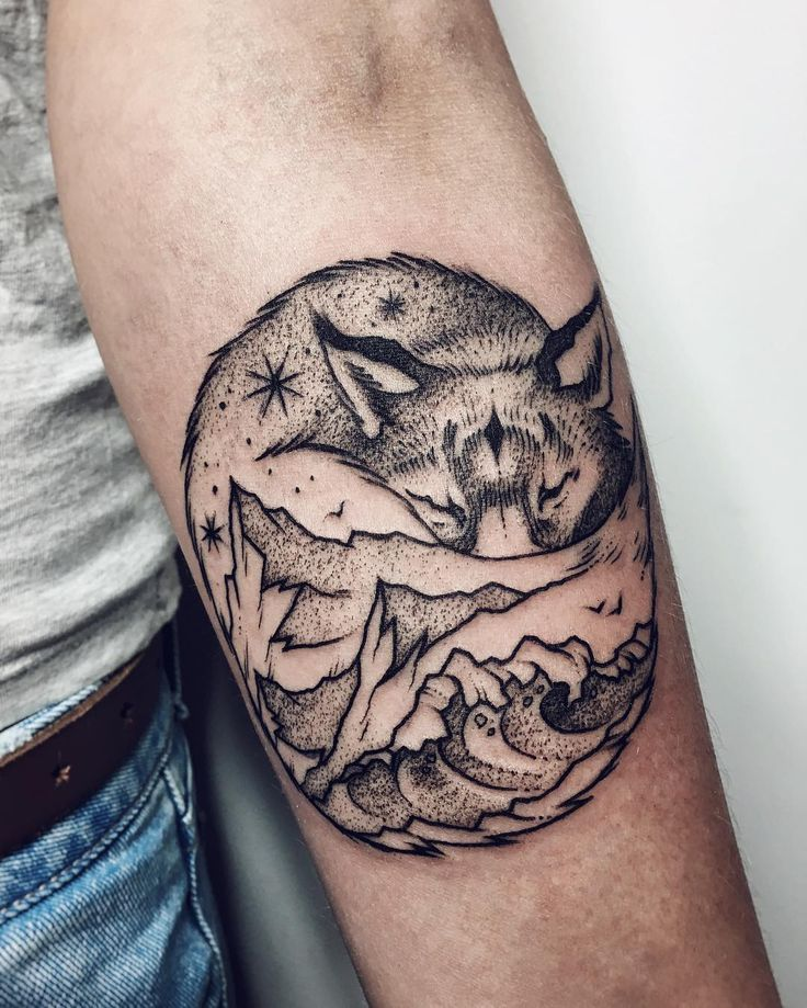 Sleeping fox and landscape tattoo