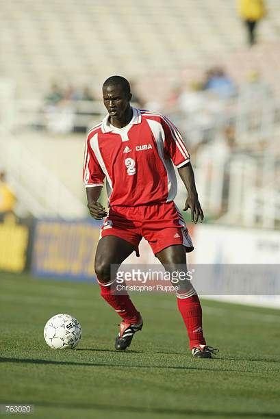 Alexander Driggs of Cuba dribbles the ball down the field during the CONCACAF Gold Cup match against the USA on January 21 2002 at the Rose Bowl in...
