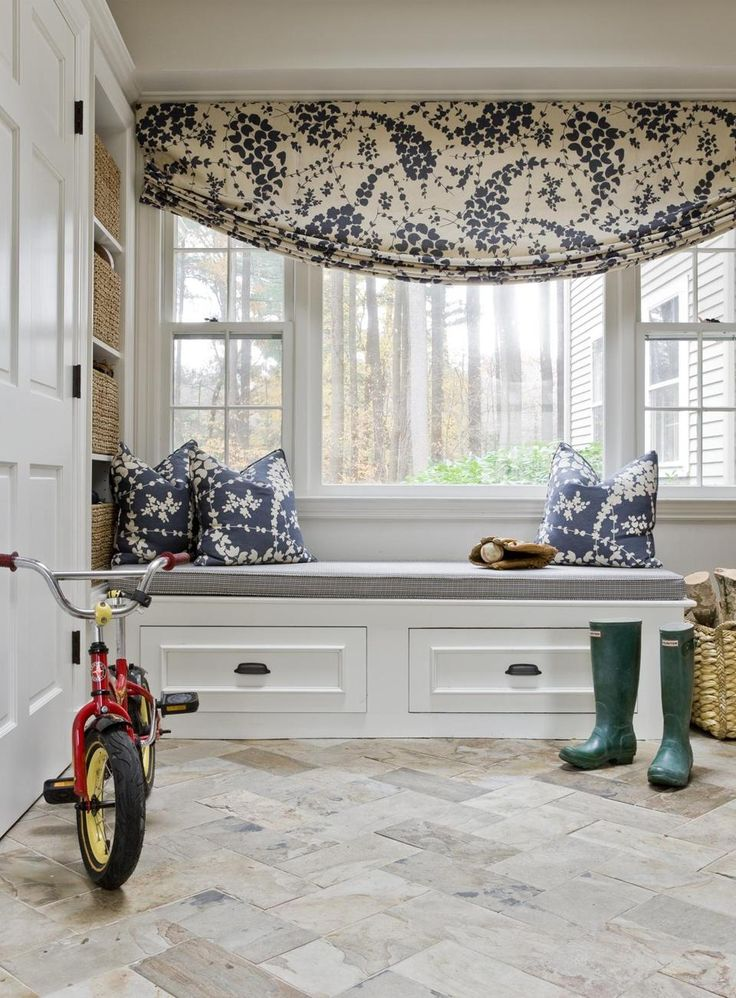 Must have a mudroom.  Revamping a childhood home: The new slate-floored mudroom has a place to sit when removing boots.