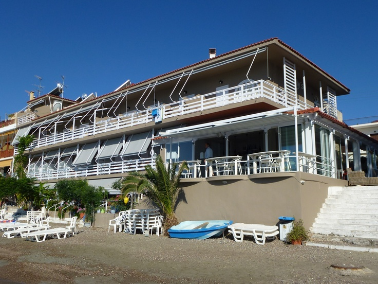 Right on the beach is Nelly's Hotel Tolo located