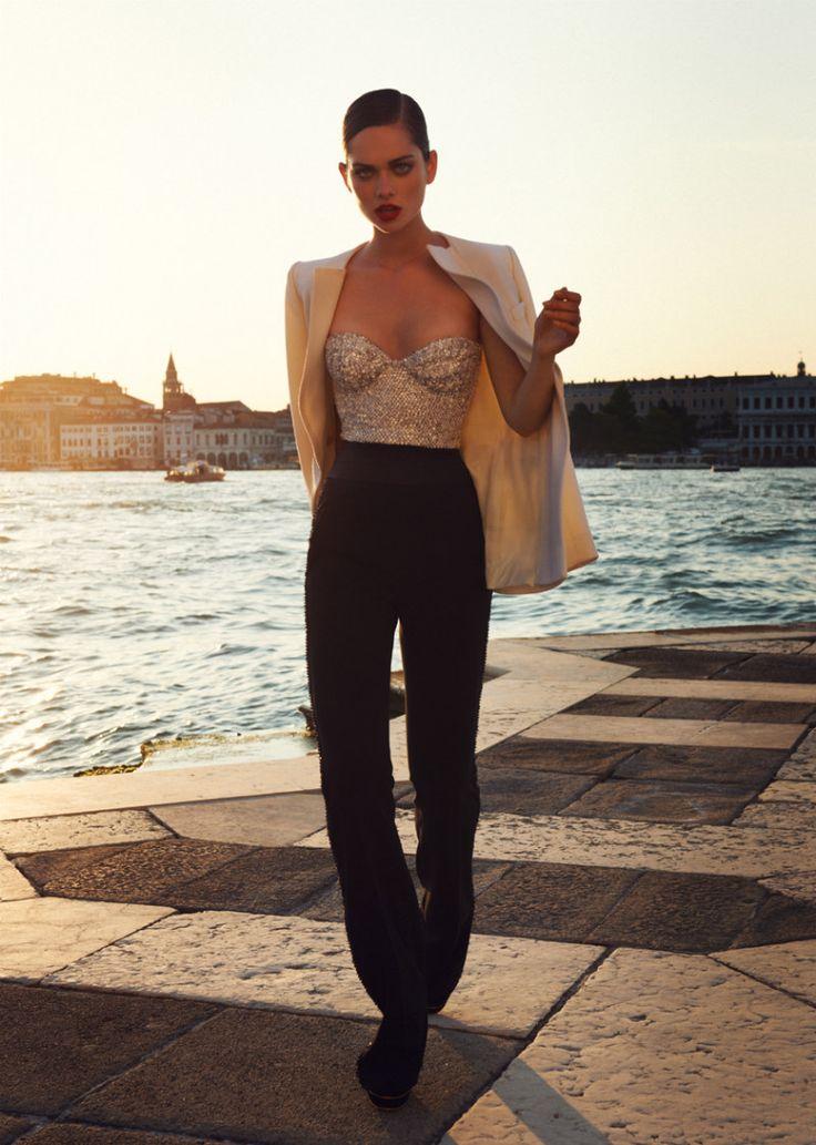 how to wear palazzo pants...a woman's alternative to the suit look...sequin bustier top, black palazzo pants, white blazer and severe side part.