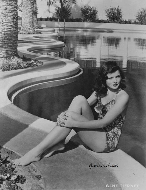 Gene Tierney sitting by a fab pool
