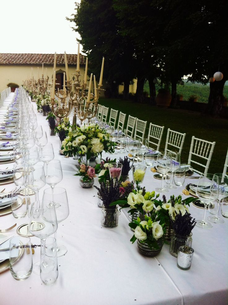 Arrangments at the table: flowers and chandeliers Castello di Meleto
