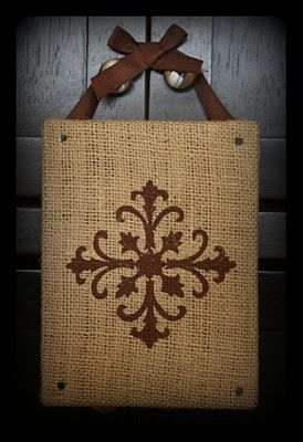 just hot glue burlap to a canvas and use a stamp or WHATEVER to make a design! hang on a wall or hot glue ribbon to it! leaf, snowflake, etc.    Christmas craft idea for me! :))