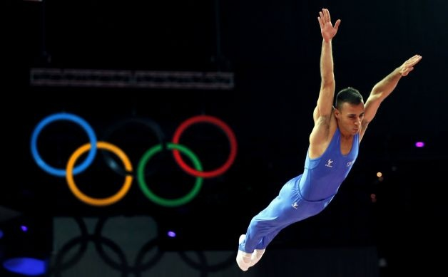 Italy's Flavio Cannone competes in the men's trampoline final of the artistic gymnastics event of the London 2012 Olympic Games in London on August 3, 2012. China's Dong Dong won the gold, Russia's Dmitry Ushakov the silver and China's Lu Chunlong bronze. (THOMAS COEX / AFP/Getty Images) / SA