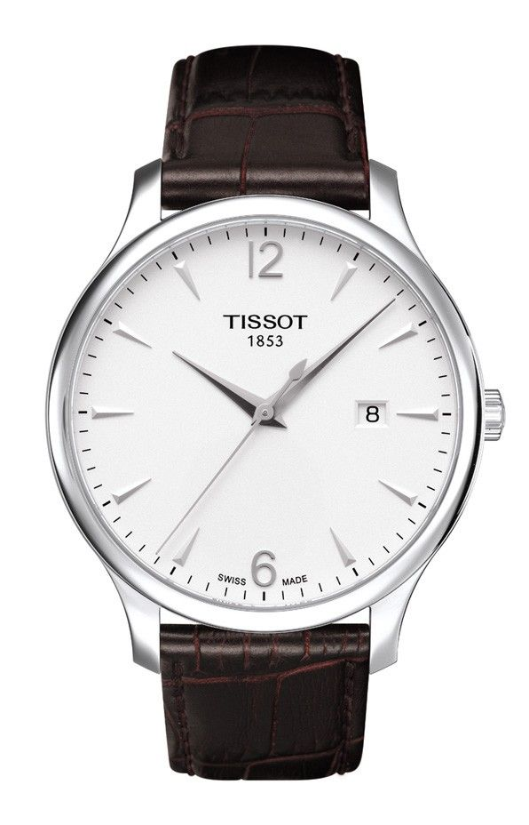 The Tissot Tradition family gives ultramodern watchmaking a justified hint of nostalgia. The Men's models are with three-hand mechanisms. High-tech operation is perfectly balanced with classical details and subtle vintage-look finishes. These are complemented by design elements such as guilloche decoration and a gently curved case. The Tissot Tradition promises wearers endless hours of precision with sustainable good looks. Shown with a silver dial and brown leather strap. Features include a…